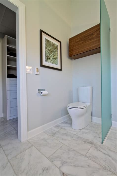 Modern Bathrooms Designs by Glass Partition Toilet Area With Walnut Storage Cabinet