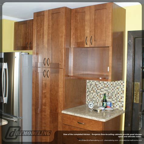 floor to ceiling wood kitchen cabinets traditional