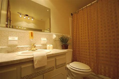 track lighting for bathroom bathroom lighting tips for home interiors realcohomes