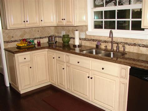 brown cabinets with white countertops plan to white cabinets or stained cabinets kitchen
