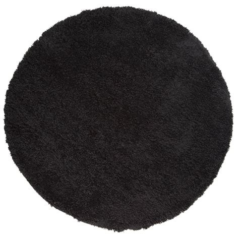 black circle rug cariboo shaggy circle rugs in black free uk delivery the rug seller
