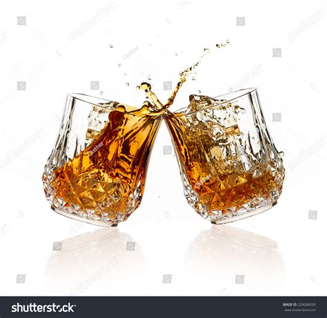 glasses cheers cheers whiskey toast two glasses clicking stock photo