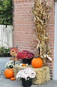 Fall Decorations With Corn Stalks by Outdoor Fall Decor Mums Hay Bale Pumpkins Harvest