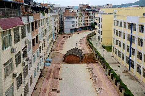 Homes On The Move china s nail houses defiant homeowners who refuse to make way for progress photos