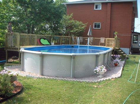 Above Ground Pool Ideas Backyard Small Fiberglass Above Ground Swimming Pools Designs With Wooden Deck Raiing For Backyard Jpg