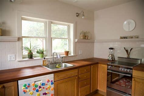 no upper kitchen cabinets no upper cabinets trim shelf to cap backsplash kitchen