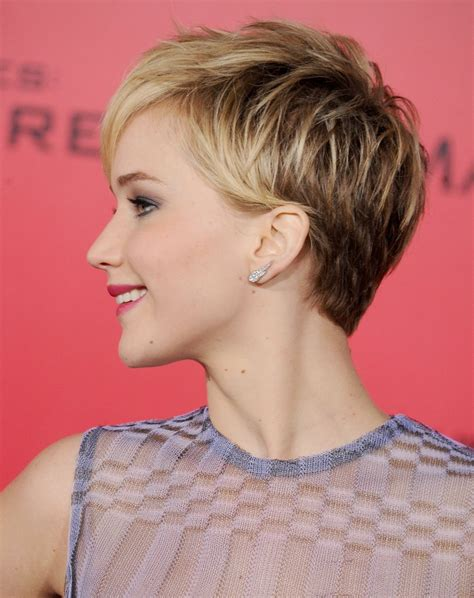 is jennifer lawrence hair cut above ears or just tucked behind jennifer lawrence s pixie jennifer lawrence s best pixie