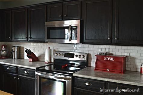 kitchen backsplash with dark cabinets hometalk white subway tile backsplash with black cabinets