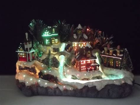 fiber optic christmas items avon fiber optic color changing town with children sledding items