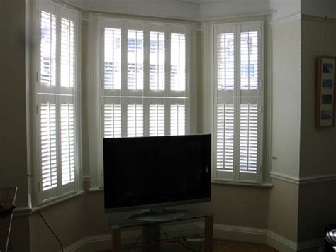 shutters with drapes changing curtains