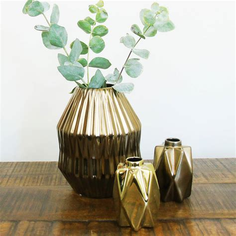 small gold geometric ceramic vase by the den now
