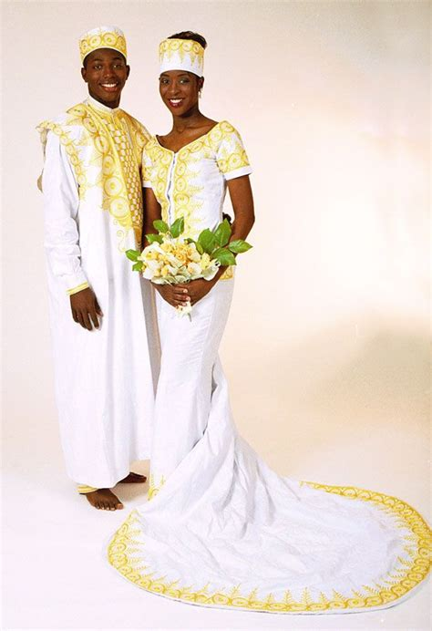 Wedding Attire Designs by Gold Embroidered Bridal Gown And Groom S Agbada