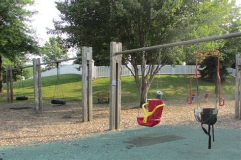 swing at the park jackson township north park playground stark county ohio