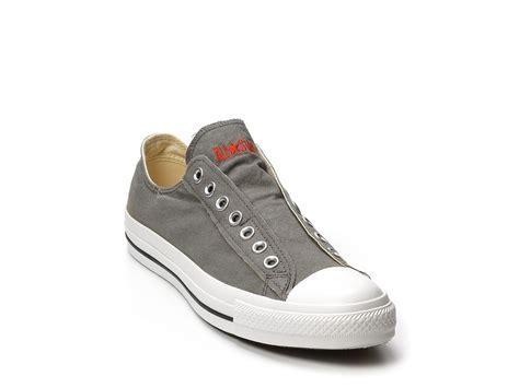 converse grey sneakers converse unisex slip on sneakers in gray grey orange lyst