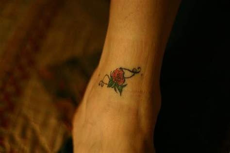 small rose flower tattoo on ankle tattooimages biz