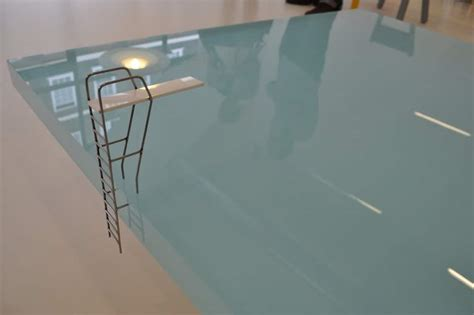 the sleek stunning swimming pool coffee table design