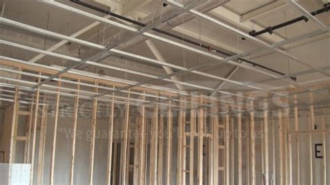 Install Drywall Suspended Ceiling Grid Systems Drop How To Install A Suspended Ceiling