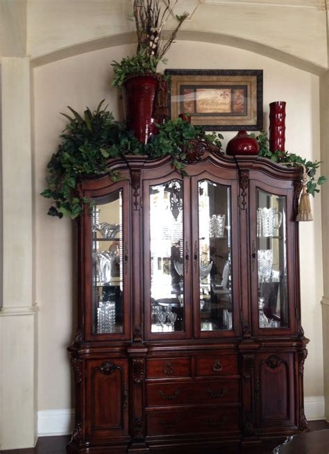 decorating ideas for top of armoire 25 best ideas about china cabinet decor on pinterest