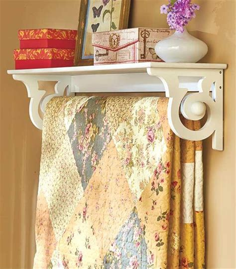 Quilt Holder For Wall by Deluxe Quilt Blanket Holder Wall Rack With Shelf Scrolled