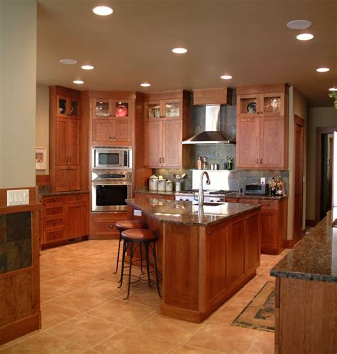 triangle kitchen cabinets warm inviting kitchen with high display cabinets