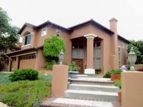 House Exterior Painting - brown stucco house paint with cream pop outs and cedar wood stain trim by maverick painting san