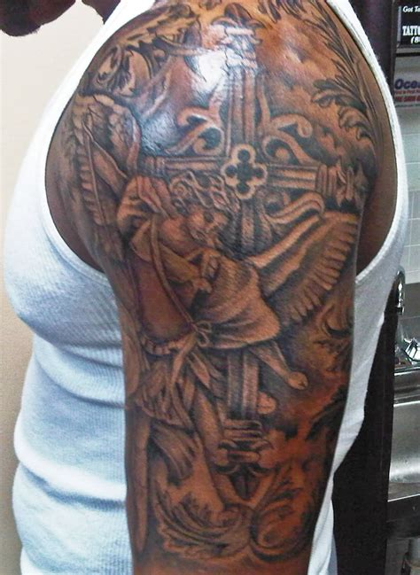half sleeve tattoo with cross 31 best christian tattoos on half sleeve