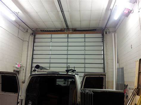 Sectional Garage Door Repair Sectional Garage Door Repair Abstract Overhead Door Fence Co