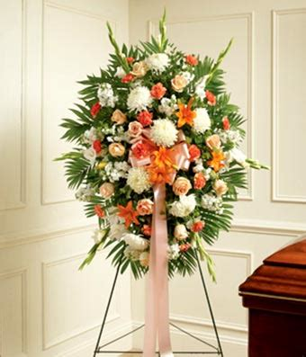 peach, orange & white flower standing spray at from you