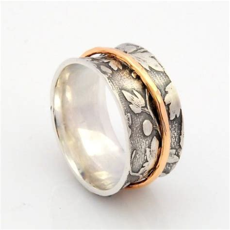 Handmade Silver And Gold Rings - silver and gold spinner ring leaf motif ring concave