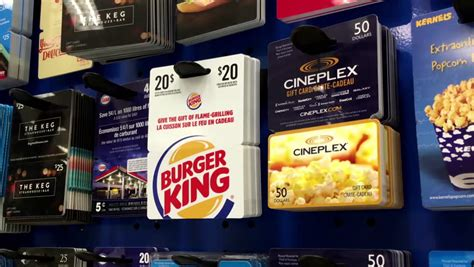 Burger King Gift Card Amount - coquitlam bc canada august 20 2015 woman picking the playstation plus one year