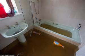 bathroom flooded what to do families in dawlish devon evacuated from their homes as