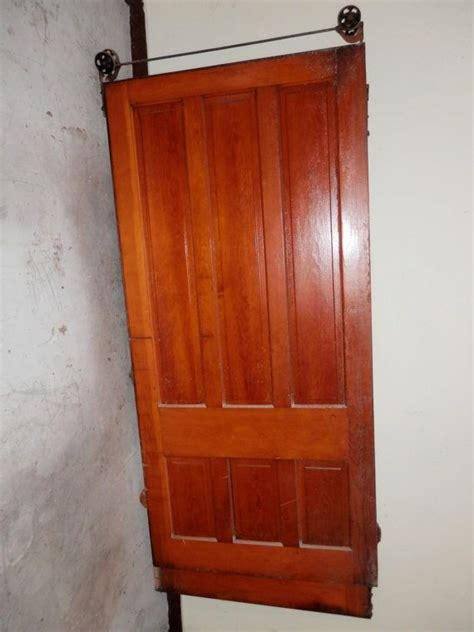 Antique Sliding Barn Doors A Antique Solid Wood Door With Rolling Hardware For Sliding Barn Style Door