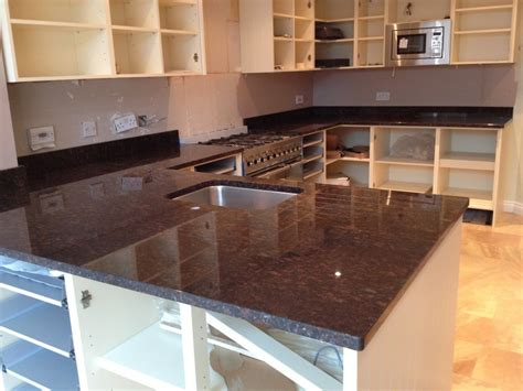 white cabinets with brown granite tan brown granite countertops in kitchen tan brown