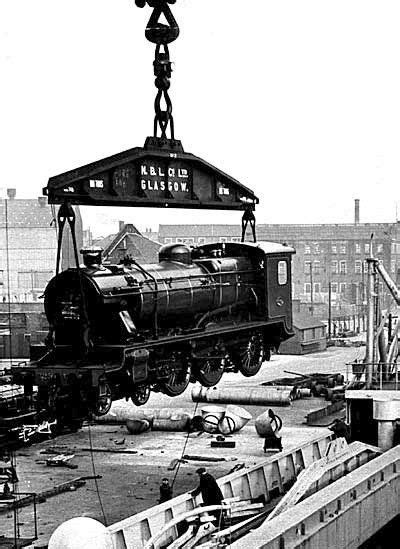 boat shop glasgow steam locomotive being loaded aboard ship by the