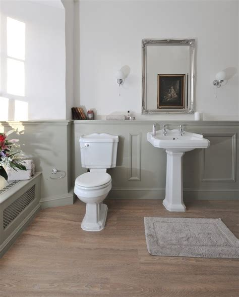 gray wainscoting bathroom traditional with wall sconces subway chair rail tiles