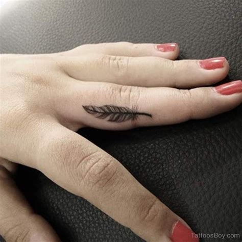 feather tattoo on hand small feather on finger designs