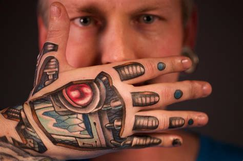 robot hand tattoo robot tattoos designs ideas and meaning tattoos for you