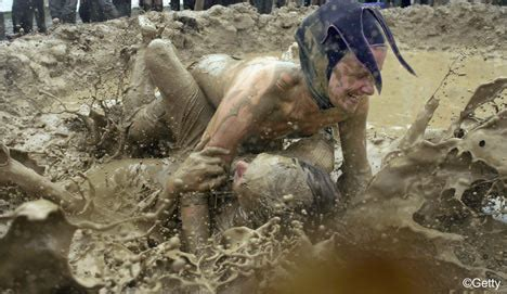 naked mud wrestlers...it could only be glastonbury | daily