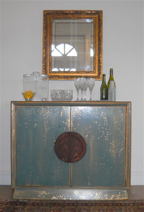 glam teal  gold cabinet eclectic dining room