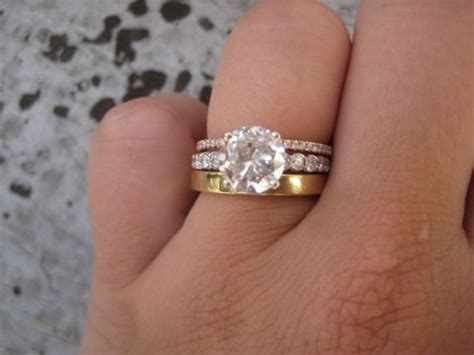 order of wedding band and engagement ring on finger heirloom wedding band mismatched with a wedding