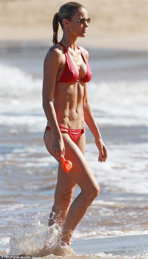 Eddie Murphy's girlfriend Paige Butcher raises temperatures in Hawaii as she models a revealing