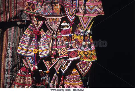 Qisa Tunic vendor selling clothes and textiles stock photos vendor selling clothes and