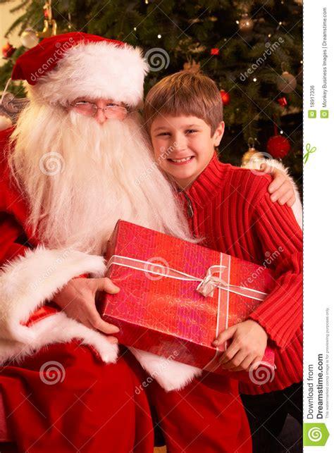 top 28 santa claus gives christmas gift santa claus