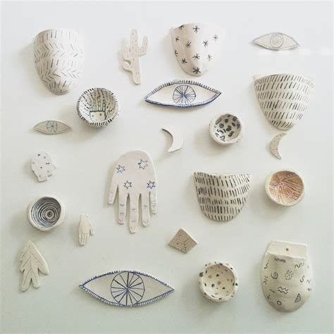 ceramics white ceramics and bags on pinterest a wall covered in tiny ceramics yes please brown
