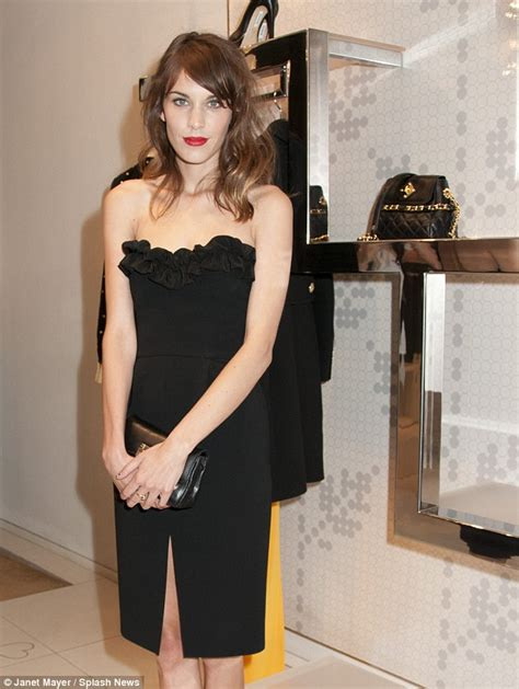 Alexa Chung hits the decks as she DJs for fashion fans at Fashion Night Out in New York Daily