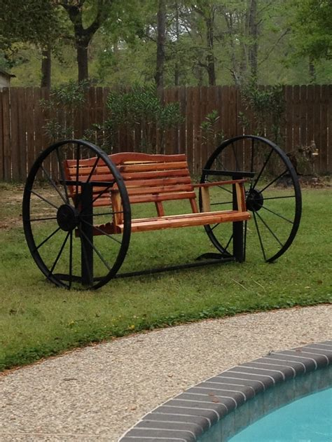 cedar swing   wagon wheel frame