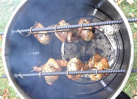 metal trash can pit pit barrel cooker smokes and grills your food unattended