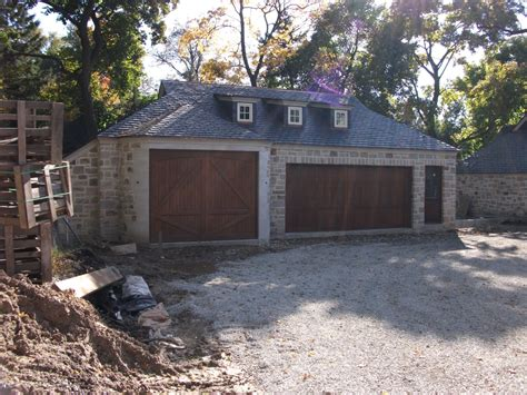 how big is a 3 car garage limestone boxwoods a stone french manor in lake forest