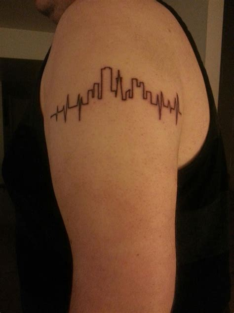 my tattoo is raised just got this heartbeat with san francisco skyline