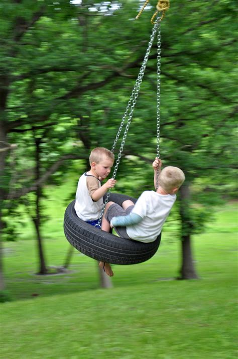 kids on swing garden landscaping playful kids tree swings for backyard